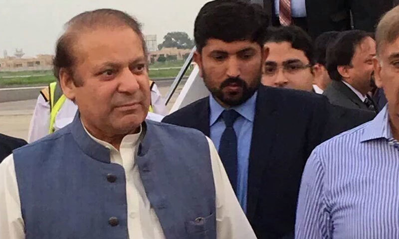 Nawaz Sharif is received at the airport. — Screen grab DawnNews