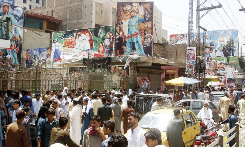 Movie fans at a cinema in Peshawar. — Dawn