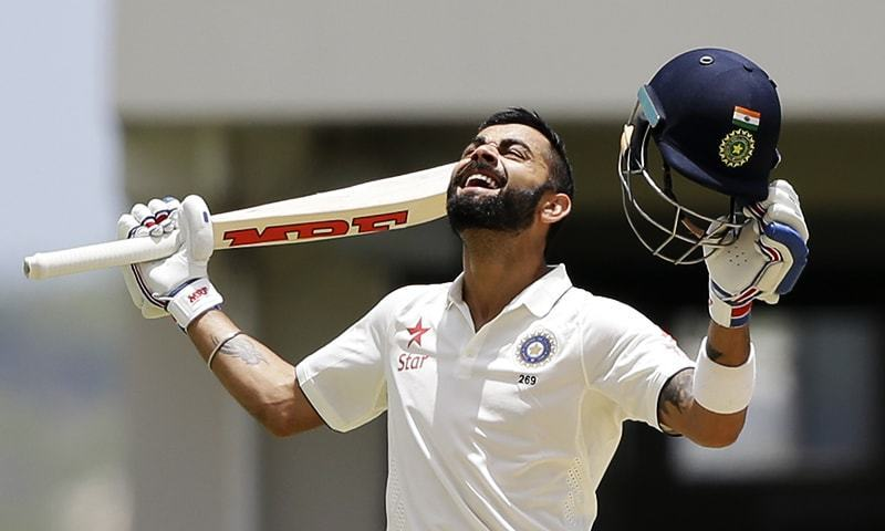India's captain Virat Kohli celebrates after scoring a double-century during day two of the first Test against West Indies in Antigua. — AP