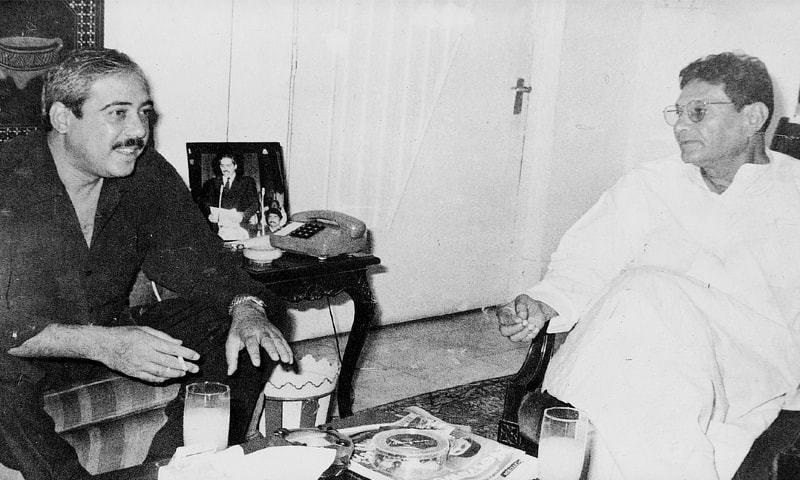 Veteran politician Mairaj Mohammad Khan in conversation with Murtaza Bhutto.— White Star Archives