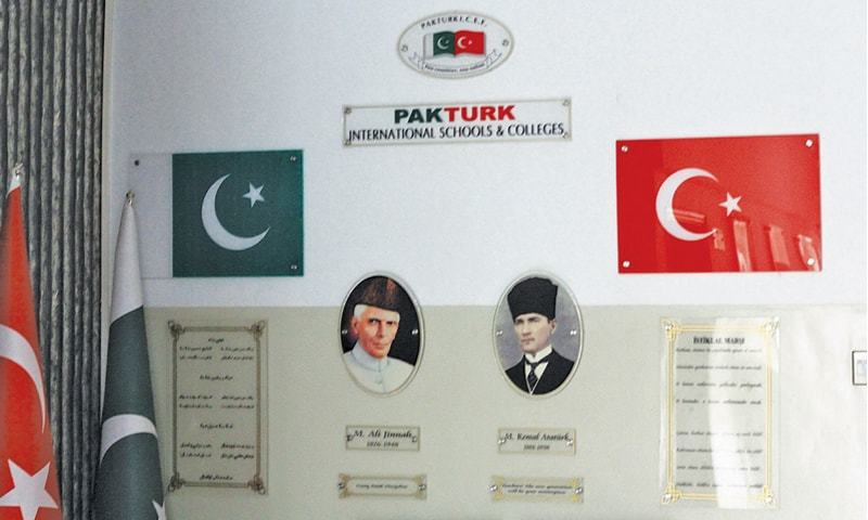 PHOTOS of Quaid-i-Azam Mohammad Ali Jinnah and Turkish leader Kemal Ataturk adorn the wall outside the principal's office at a PakTurk school in Karachi.—Aamir Baig / Dawn.com