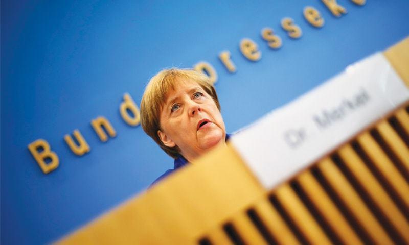 BERLIN: German Chancellor Angela Merkel addresses a news conference on Thursday.—Reuters