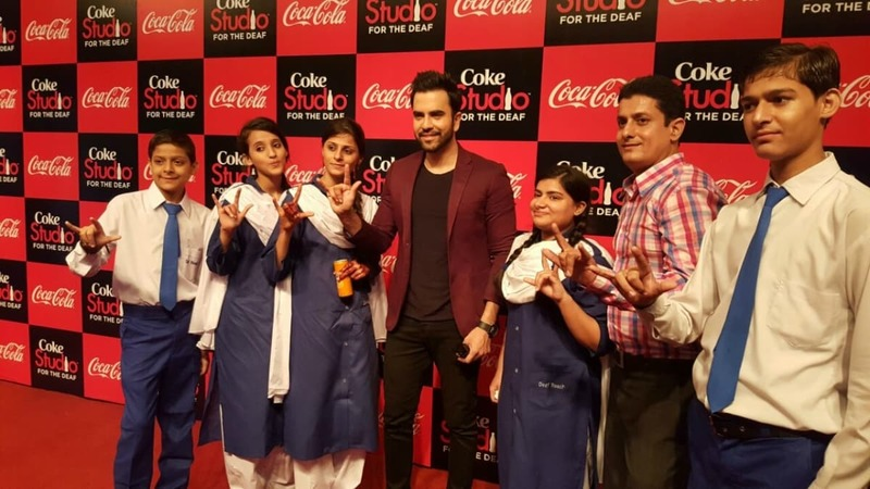 Musician/actor Junaid Khan with hearing-impaired students at the launch of Coke Studio for the Deaf