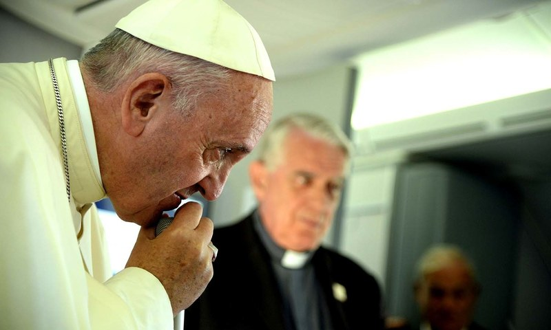 Pope Francis listens to a journalist's question on board the flight from Krakow, Poland, to Rome. ─AP