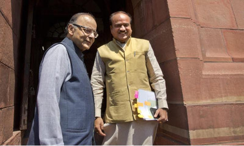 Indian Finance Minister Arun Jaitley with Indian Minister for Chemicals and Fertilizers, Ananth Kumar, arrive at the parliament house in New Delhi. —AP