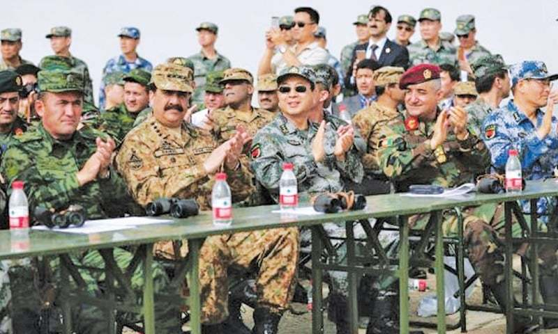 URUMQI: (From right) Qadam Shah Shahim of the Afghan National Army, Gen Fang Fengui of China, Chief of Army Staff Gen Raheel Sharif and Maj Gen E.A. Cobidrzoda of Tajikistan pictured during a military exercise on Wednesday.