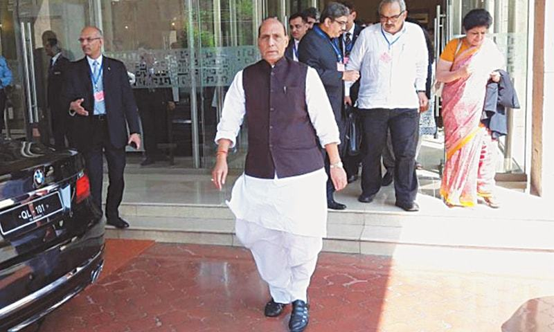 ISLAMABAD: Indian Home Minister Rajnath Singh leaves the venue of the Saarc meeting.—INP