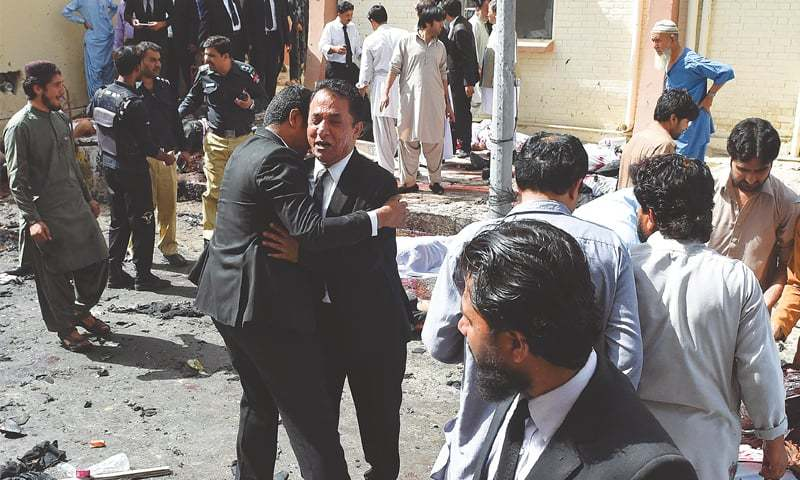 LAWYERS react as they gather at the scene of the suicide attack on the Civil Hospital premises on Monday.—AFP