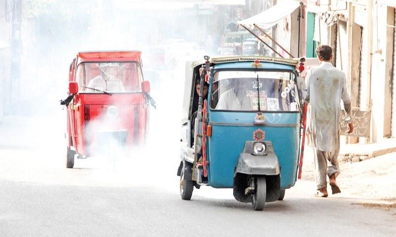 Rickshaws polluting the air in Mingora. —Dawn