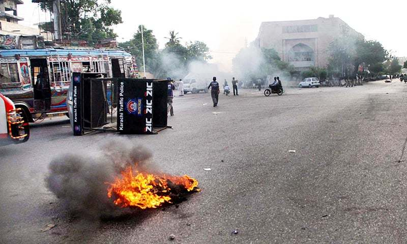 A police van and motorcycle of a traffic police official were reportedly set on fire. —Online