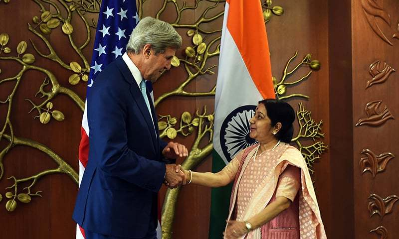 Indian Minister of External Affairs Sushma Swaraj and US Secretary of State John Kerry shake hands prior to a meeting in New Delhi. -AFP