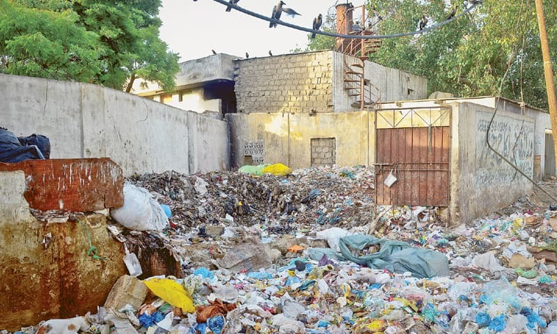 Piles of waste lie outside the incinerator at the Jinnah Postgraduate Medical Centre.—Fahim Siddiqi / White Star