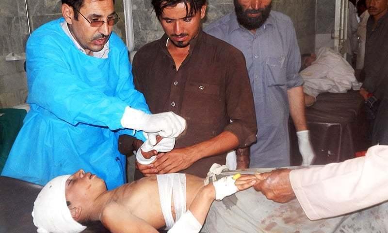 Paramedics treat an injured blast victim at a hospital in Bajaur Agency.— AFP