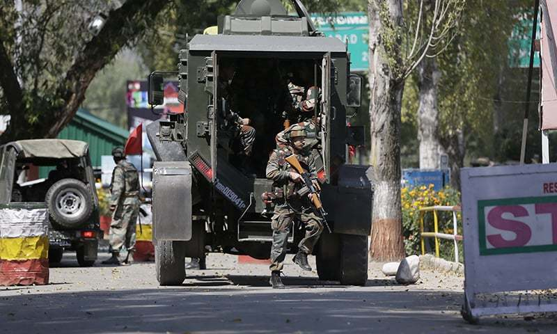 Indian army soldiers arrive at the army base which was attacked by suspected rebels in the town of Uri. —AP