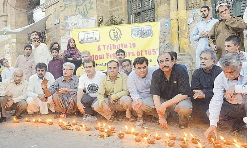 Scholars and other learned individuals of Karachi gather for a vigil outside Empress Market in memory of the heroes of the 1857 uprising executed there by the British.—Anis Hamdani / White Star