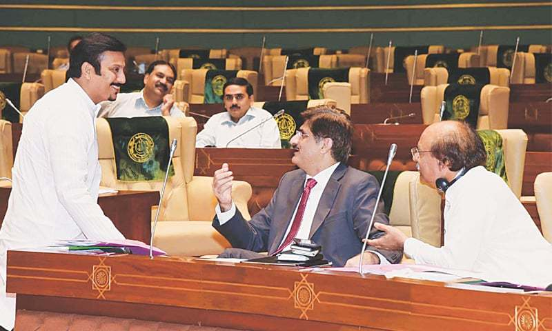 Chief Minister Syed Murad Ali Shah and MQM lawmaker Faisal Ali Sabzwari exchange pleasantries as the latter arrived to attend the Sindh Assembly session on Monday.—Online
