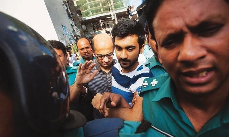 File picture shows Bangladesh police escort Canadian university student, Tahmid Hasib (centre right) towards the court as suspects in the Holey Artisan Bakery terror attack.—AFP/File