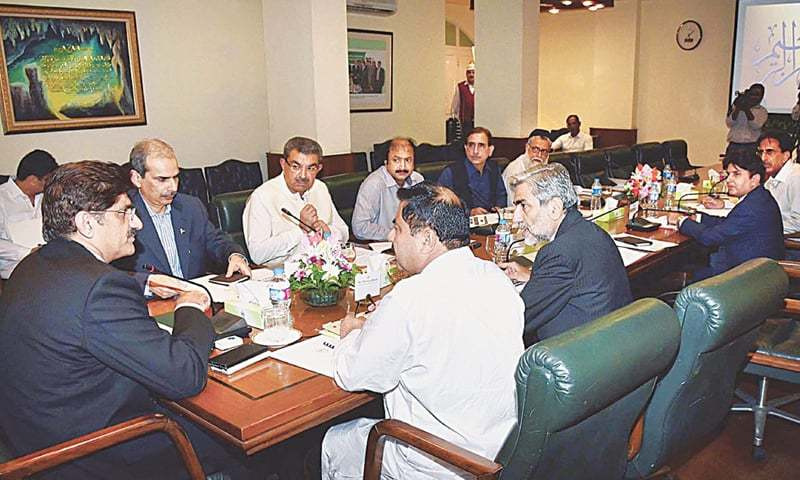 Sindh Chief Minister Murad Ali Shah presides over a meeting on katchi abadis at CM House on Thursday.—APP