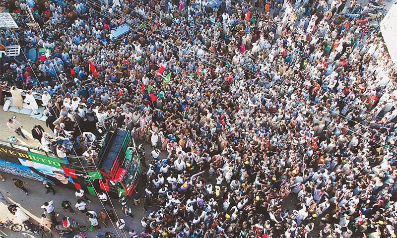 KARACHI: PPP's procession in memory of the 2007 Karsaz bomb attack victims passes through Lyari on Sunday.—INP