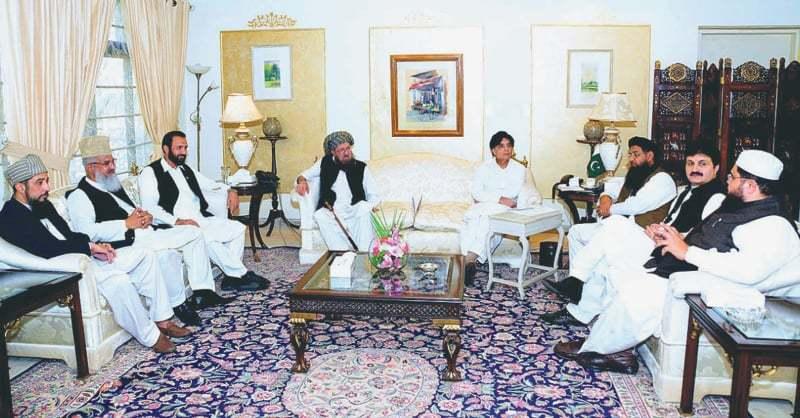 ISLAMABAD: A delegation of the Difa-i-Pakistan Council led by Maulana Samiul Haq calling on Interior Minister Chaudhry Nisar Ali Khan at Punjab House on Friday.—APP