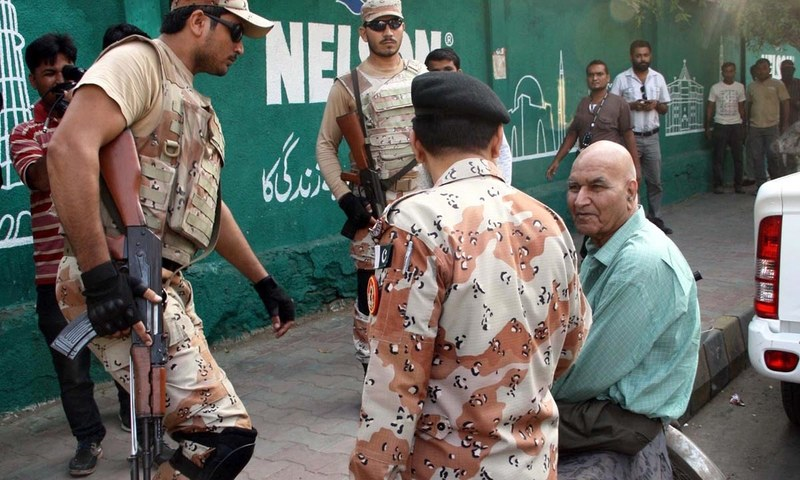 Rangers arrest member of MQM London Prof. Hassan Zafar before a press conference at Karachi Press Club. —Online