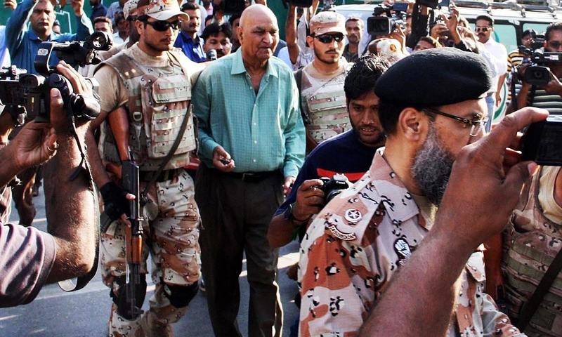 Rangers escort member of MQM London Prof Hassan Zafar who was arrested before a press conference at Karachi Press Club. —Online