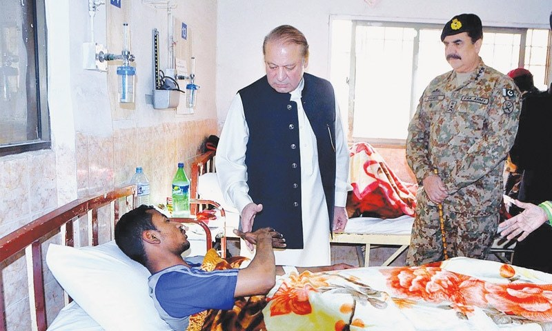 PRIME Minister Nawaz Sharif and Chief of the Army Staff Gen Raheel Sharif inquiring after the health of an injured cadet at the Sandeman Civil Hospital on Tuesday.—APP