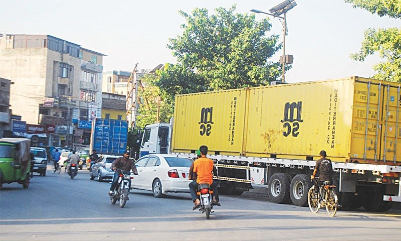 TRAILERS with containers seen parked in Rawalpindi near New Town Police Station to block roads to stop participants of the Pakistan Tehreek-i-Insaf's protest on Nov 2.—Online