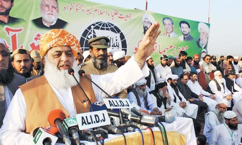 JUI-F chief Maulana Fazlur Rehman addressing a public gathering at Azakhel on Thursday.—Online