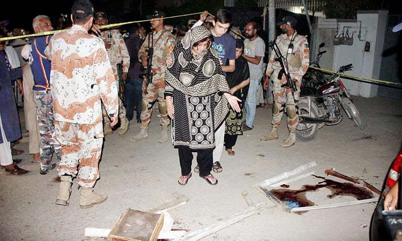Woman seen at the scene of homicide after firing by unknown terrorists during Majlis-i-Aza. —Online
