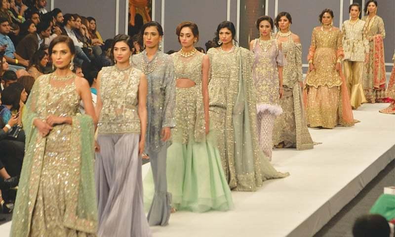 Models show Jeem by Hamza Bokhari on Day One of the ongoing Fashion Pakistan Week '16. —Faysal Mujeeb / White Star