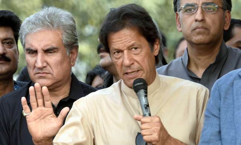 PTI chairman Imran Khan addresses PTI workers outside Bani Gala. —Reuters