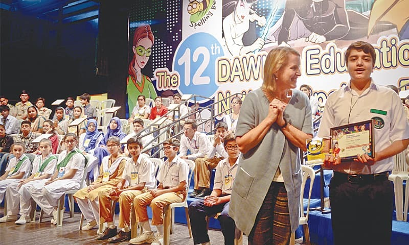 US consul general Grace W. Shelton with Aryan Tauqeer, the winner in the 12 to 14 age group of the 12th Dawn in Education National Spelling Bee regional championship.—Fahim Siddiqi / White Star