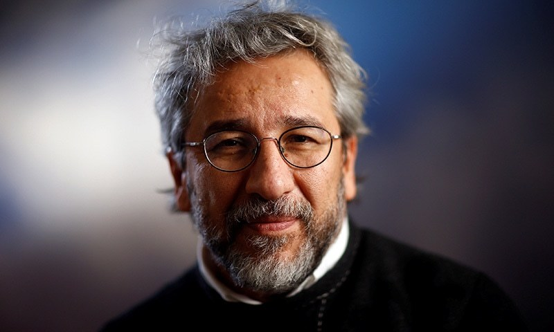Can Dundar, former editor-in-chief of Cumhurryiet, Turkey's main opposition newspaper which was raided by Turkish police on Monday, is pictured after an interview with Reuters in Berlin. ─Reuters
