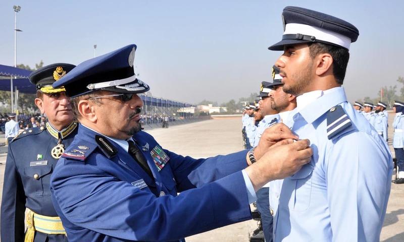 Commander Saudi Air Force Major General Mohammad Saleh Al Otaibi awarding branch insignia to a Saudi cadet. –Online