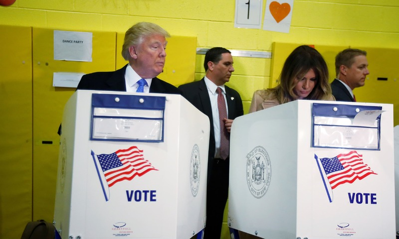 Donald Trump and his wife Melania Trump vote at PS 59 in New York. —Reuters