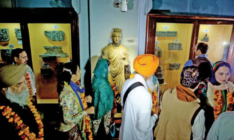 Sikh yatrees visit Peshawar Museum on Friday. —Photo by Shahbaz Butt
