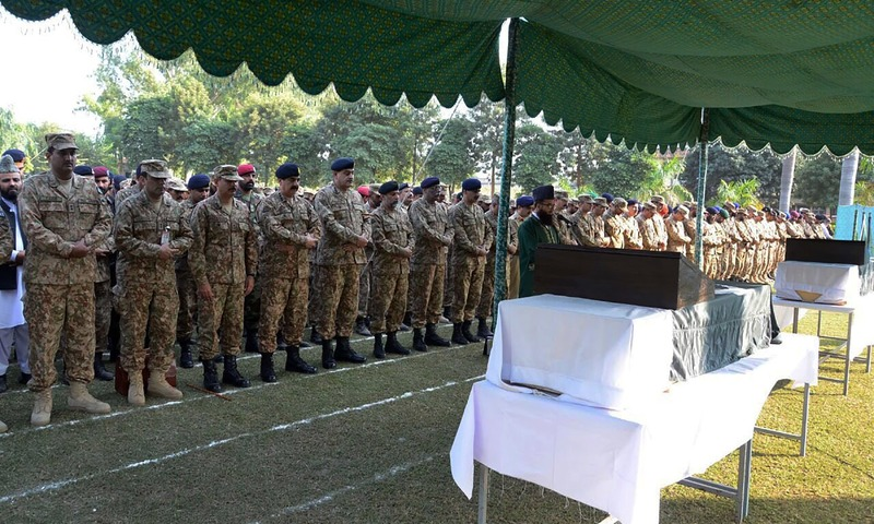 Gen Raheel Sharif and military officials offer funeral prayers for soldiers who were killed in cross-border firing at the LoC. —AFP