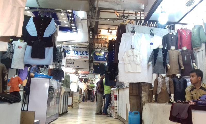 KARACHI: Shopkeepers at Cooperative Market in Saddar area await customers on Tuesday.—Fahim Siddiqi