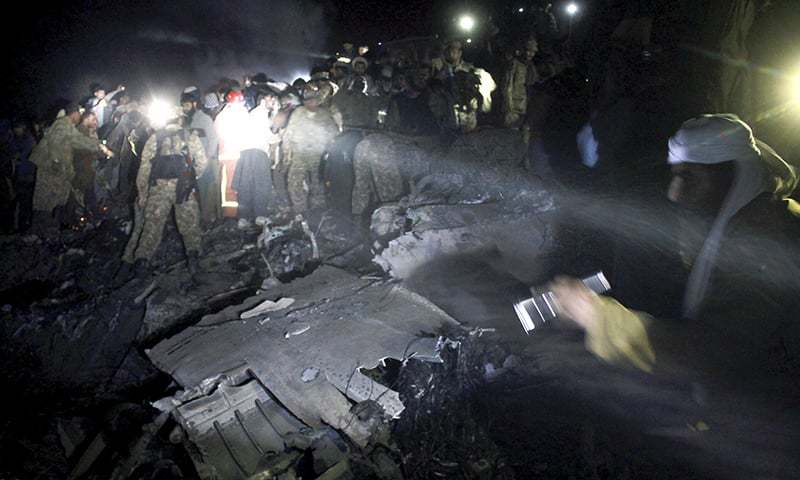 Pakistan Army troops and rescue workers search for bodies at the site. -AP