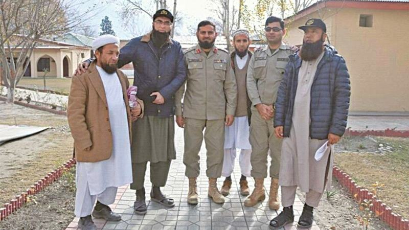 Junaid Jamshed (second left) with Pakistan Army officers during his visit to the headquarters of Chitral Scouts on Wednesday. Saeed Anwar (far right), a former test cricketer and close friend of Jamshed, is also seen. The picture was taken hours before the plane crash.—Dawn
