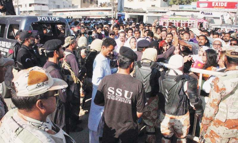 Scuffle ensues as Rangers restrain MQM-London workers near Mukka Chowk