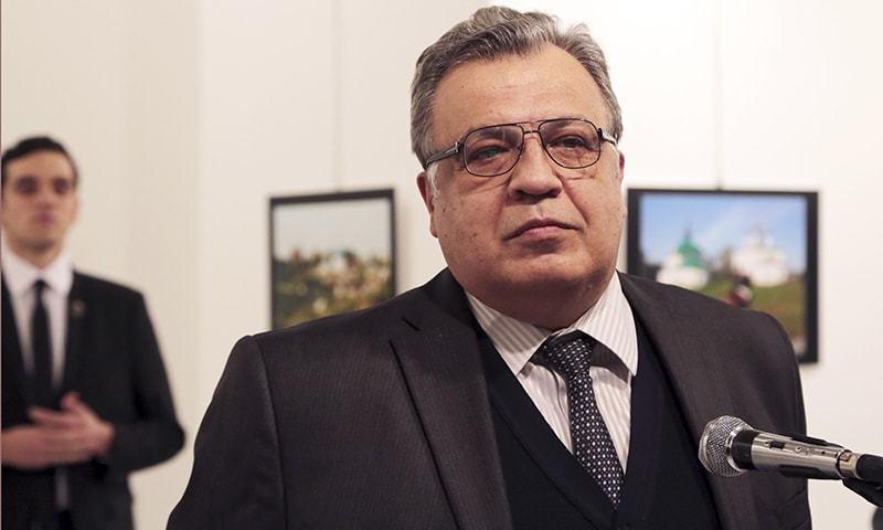Andrei Karlov, the Russian Ambassador to Turkey, speaks at a photo exhibition in Ankara. -AP