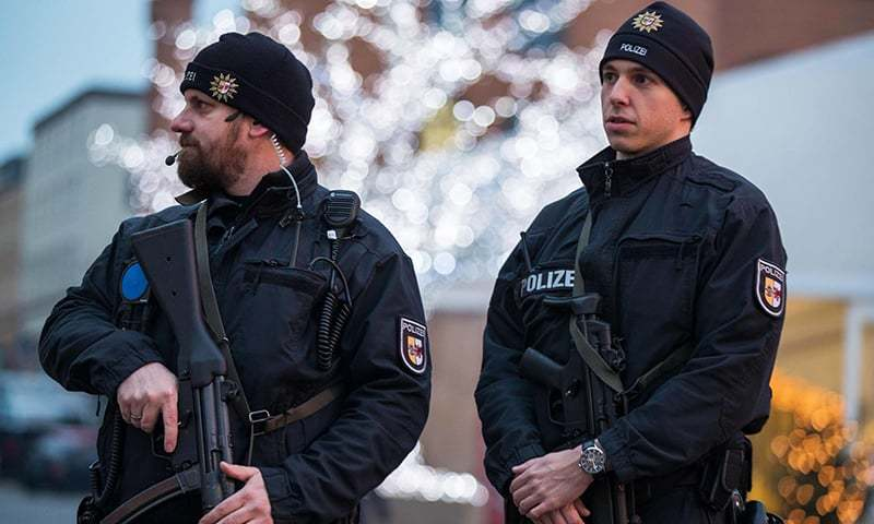 Armed policemen stand at the Christmas market in Schwerin, northern Germany. -AFP