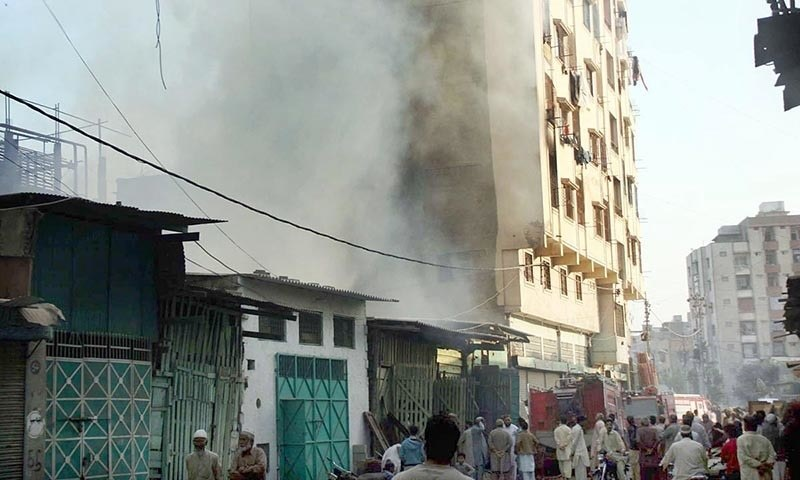 Smoke seen rising high after fire erupted in Haji Camp Timber Market. —Online
