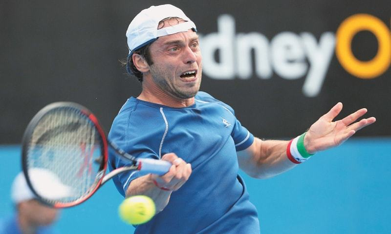 Sydney: Paolo Lorenzi of Italy hits a return to Serbia's Viktor Troicki during their second-round match at the Sydney International on Wednesday.—AFP