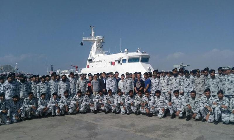 GWADAR: A group photo of senior Chinese and Pakistani Navy officials at the handover ceremony of two ships by China to Pakistan here on Saturday.—Dawn