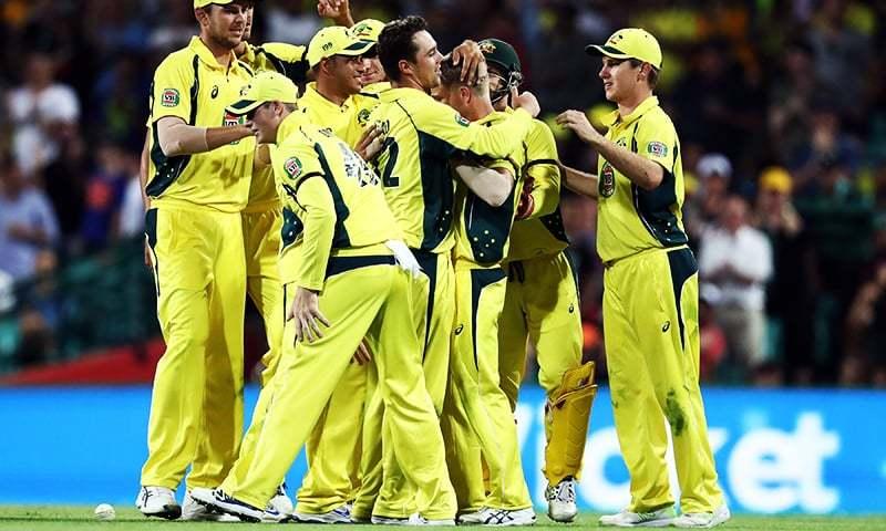 Australia's David Warner (3rd R) gets mobbed by teammates after