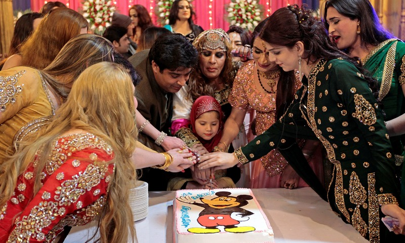 Guests cut a cake at Shakeela's party in Peshawar. —Reuters