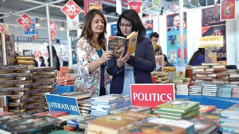 Visitors scope out the titles on offer at the Lahore International Book Fair